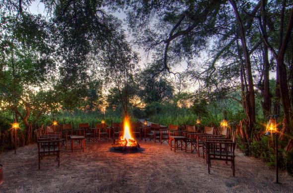 Spend your evenings around a crackling boma fire.