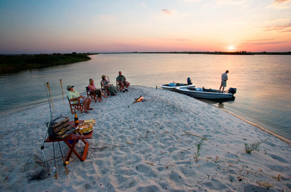 Sun-downers on the river at Ntwala Island Game Lodge. Caprivi