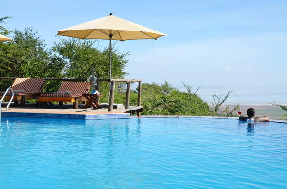 Guest luxuriating in the Escarpment Luxury Lodge infinity pool.