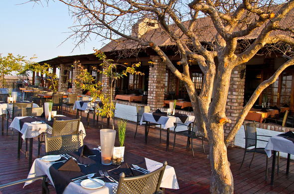 Open-air dining on the deck at Etosha Safari Lodge.