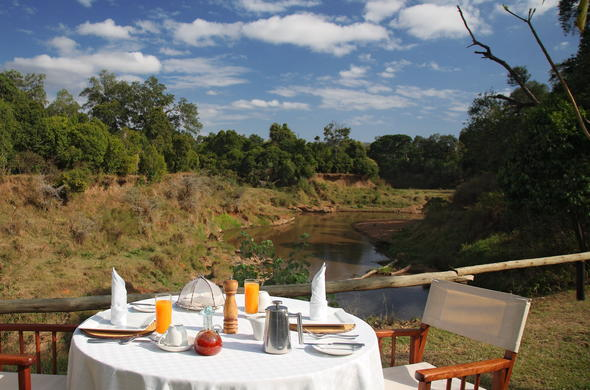 Enjoy breakfast at Governors IL Moran Camp on the banks of the Mara River.