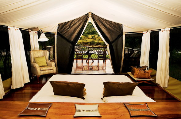 Karen Blixen Camp tents are located on platforms under thatched roofs.