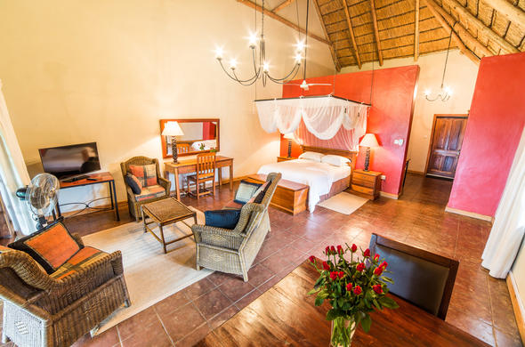 Spacious and cosy bedroom at Kumbali Country Lodge.
