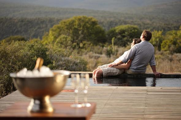 A couple relaxing at Kwandwe Private Game Reserve.