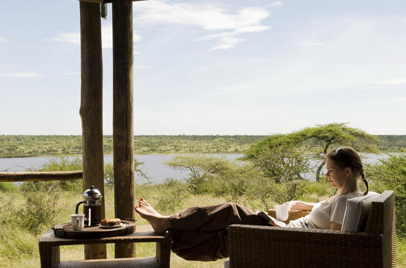 Relax on the private deck of Lake Masek Tented Camp.