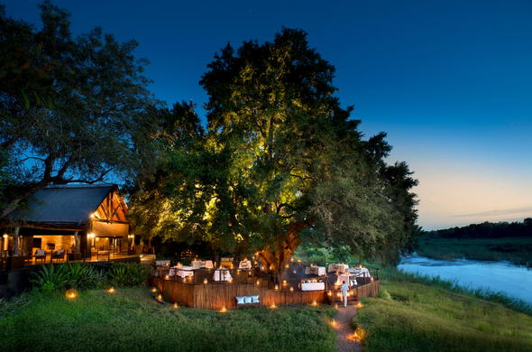 Dinner is served under a tree on the deck in Kruger.