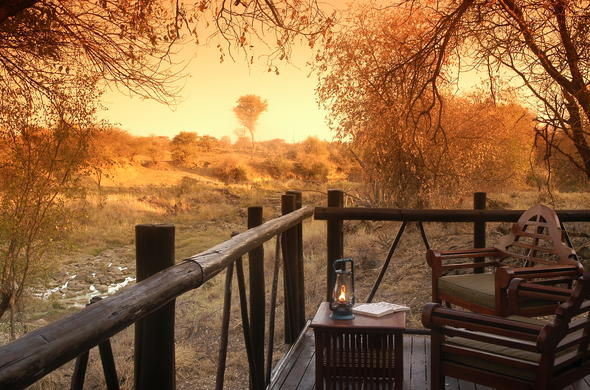 Relax on the private patio with a book at Madikwe River Lodge.