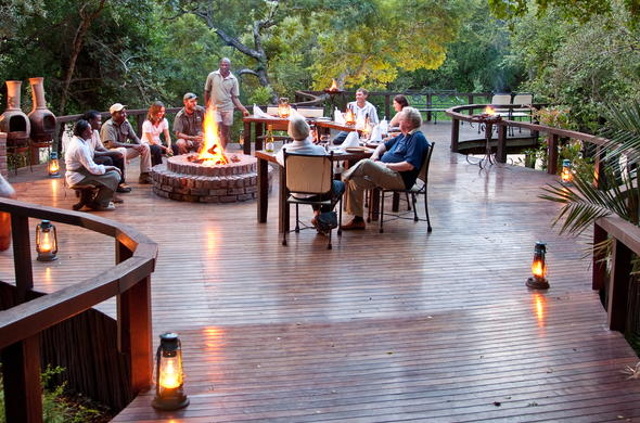 Gather around the boma for drinks before dinner.
