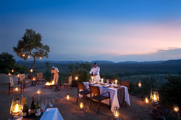 Family dinner under the African sky in malaria free Madikwe.