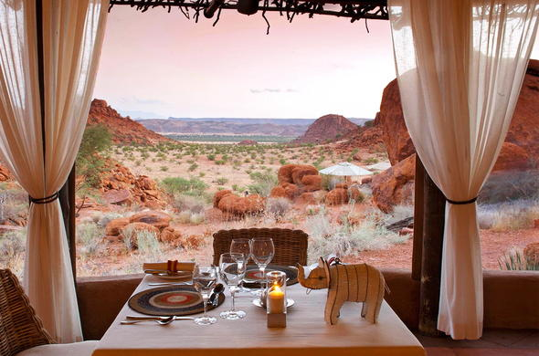 Dinner table set for two with uninterrupted Twyfelfontein views.