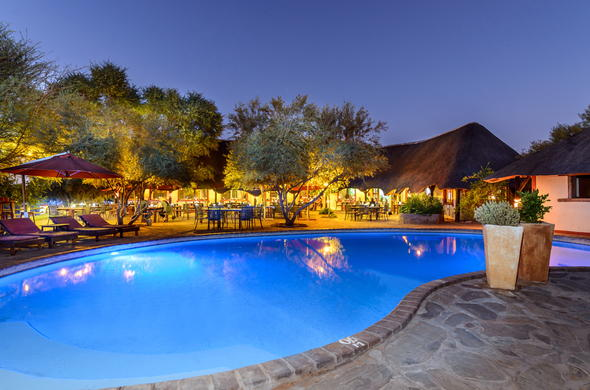 Swimming pool area of Namib Desert Lodge by night.