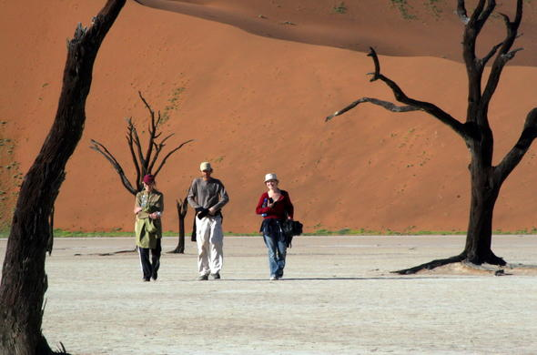 Walking the pans of the Deadvlei in Namibia.