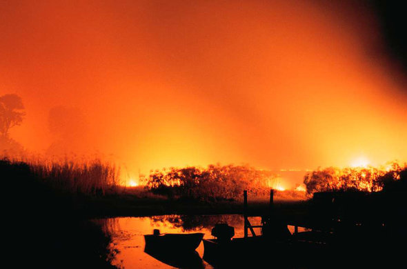 Uncontrolled fires that annually burn over 30 percent of the Okavango and environs.. Ian Michler