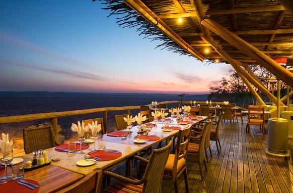 Table set for an evening of dining on the Ongava Lodge deck.