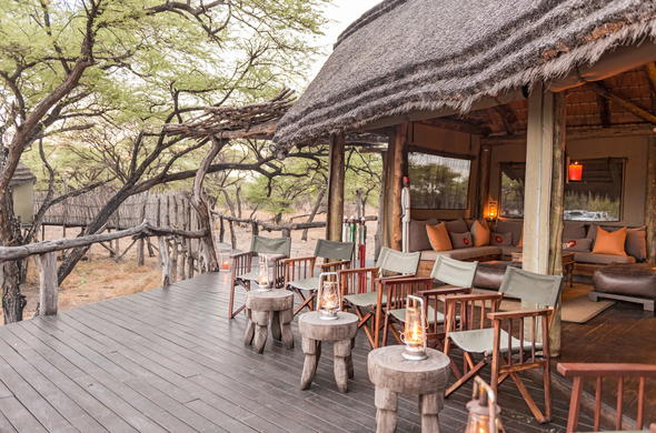 Guests can relax on the deck lounge of Onguma Tree Top Camp.