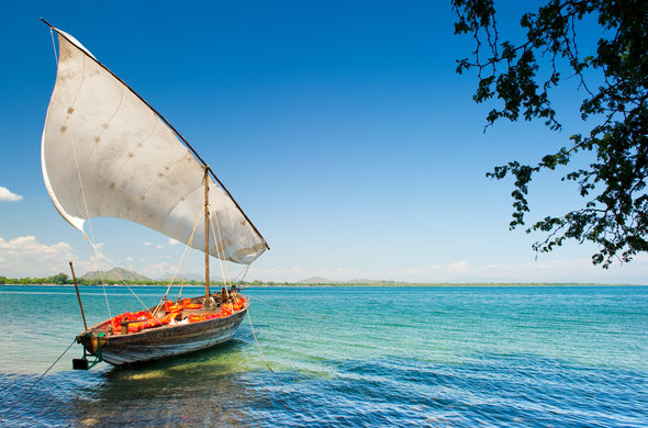 Dhow cruise departing from the beach in Lake Malawi.