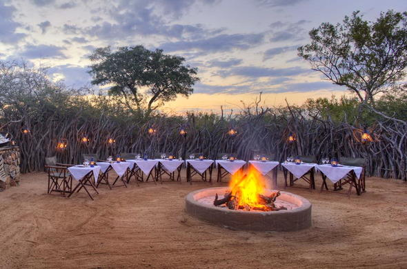 Spectacular boma dinner around a roaring fire.
