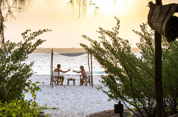 Enjoy a romantic sunset in Zanzibar with your loved one.