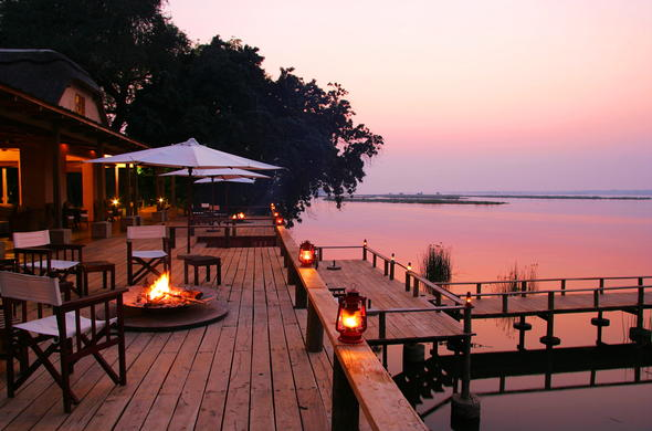 Cosy evenings around the campfire on the terrace at Royal Zambezi Lodge.