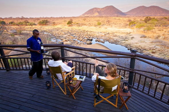 Kick back and relax on the private deck of Ruaha River Lodge.