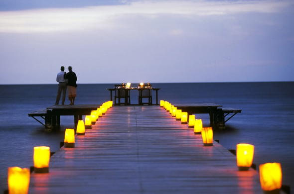 Romantic dinner for two on the Rusinga Island Lodge jetty.