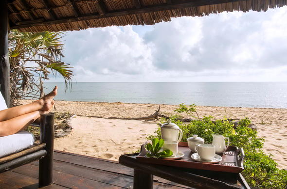 Relax on the sandy beach with Indian Ocean views.
