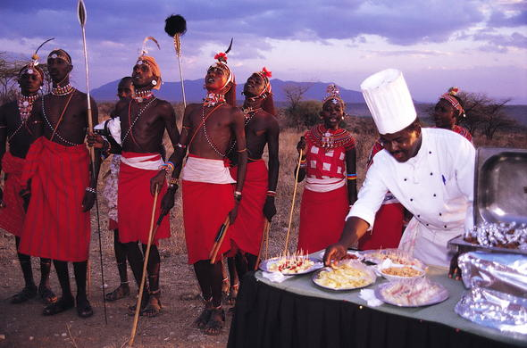 Samburu Intrepids bush dining experience includes Maasai dancers and exquisite food.