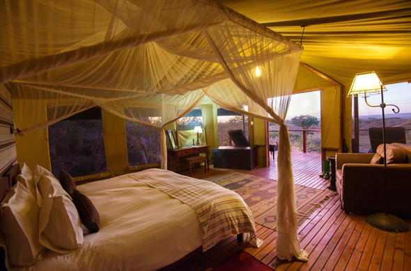 Sanctuary Kusini Tented Camp accommodation with private patio.