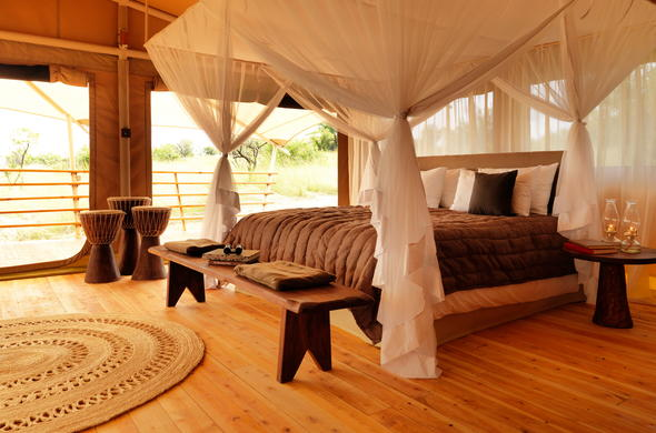 Large double bed in the Family Tent at Serengeti Bushtops.