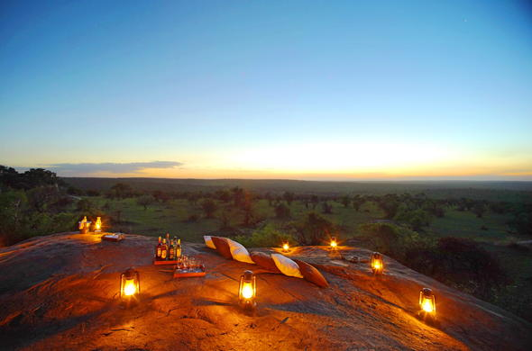 Watch the sunset and enjoy drinks at Simba Rock.