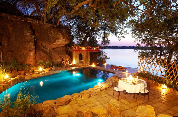 Romantic dining location next to the Zambezi River.