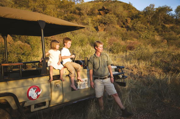 Kids on a game drive in Madikwe Game Reserve.